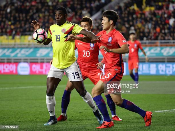 Duvan Zapata of Colombia competes for the ball with Kwon KyungWon of South Korea during the international friendly match between South Korea and...