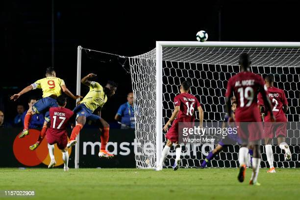 Duvan Zapata of Colombia heads the ball to scor the opening goal during the Copa America Brazil 2019 group B match between Colombia and Qatar at...