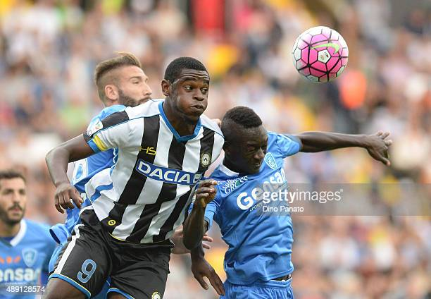 Duvan Zapata of Udinese Calcio battles for an aerial ball with Assane Diousse Empoli FC during the Serie A match between Udinese Calcio v Empoli FC...