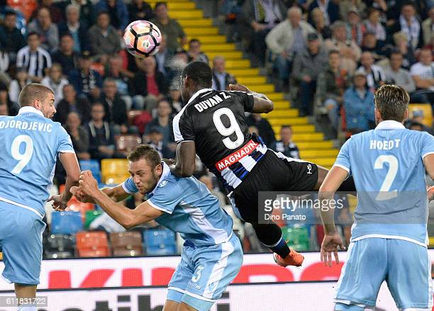 Duvan Zapata of Udinese Calcio battles for an aerial ball with Sefan De Vrij of SS Lazio during the Serie A match between Udinese Calcio and SS Lazio...