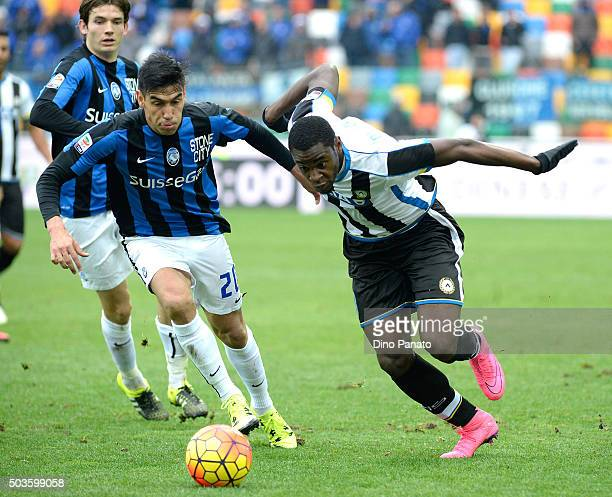 Duvan Zapata of Udinese Calcio competes with Marcelo Estigarribia of Atalanta BC during the Serie A match between Udinese Calcio v Atalanta BC at...