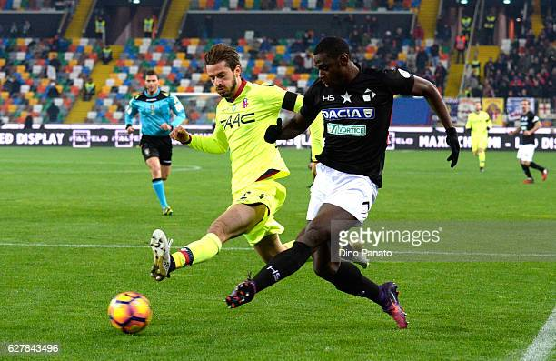 Duvan Zapata of Udinese Calcio competes with Marios Opikonomou of Bologna FC during the Serie A match between Udinese Calcio and Bologna FC at Stadio...