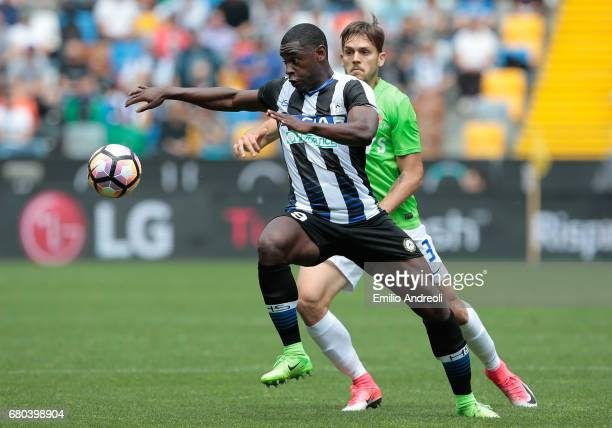 Duvan Zapata of Udinese Calcio is challenged by Rafael Toloi of Atalanta BC during the Serie A match between Udinese Calcio and Atalanta BC at Stadio...
