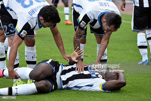 Duvan Zapata of Udinese Calcio lay down injured after scoring his team's second goal during the Serie A match between Bologna FC and Udinese Calcio...