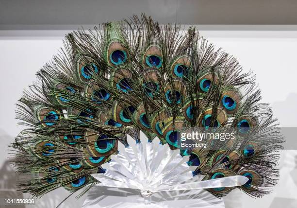 A Duvelleroy peacock feather fan stands on display during the 'Homo Faber Crafting a More Human Future' exhibition in Venice Italy on Wednesday Sept...