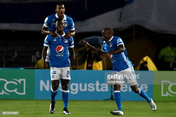 Duvier Riascos of Millonarios celebrates with teammates after scoring the first goal of his team during a match between Millonarios and America de...