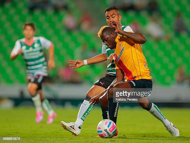 Duvier Riascos of Morelia and Rodolfo Salinas of Santos fight for the ball during a match between Santos Laguna and Morelia as part of 12th round...