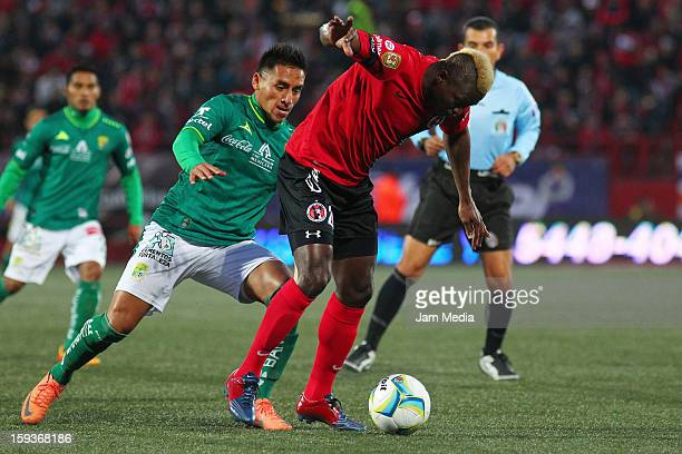 Duvier Riascos of Tijuana struggles for the ball with Jorge Zatarain of Leon during the Clausura 2013 Liga MX at Caliente Stadium on january 12 2013...