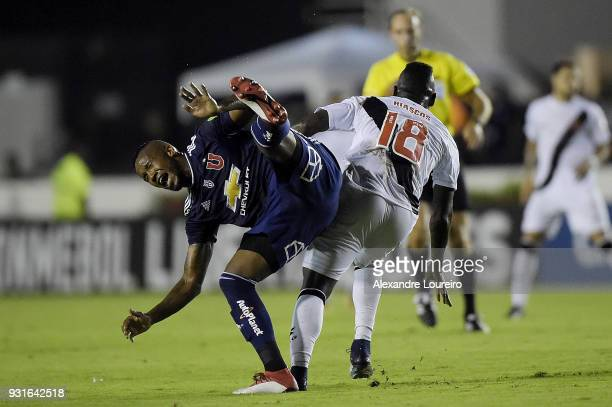 Duvier Riascos of Vasco da Gama struggles for the ball with Rafael Vaz of Universidad de Chile during a Group Stage match between Vasco and...