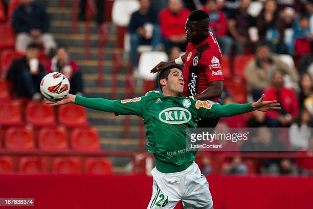 Duvier Riascos of Xolos de Tijuana fights for the ball with Marcelo Ferreira of Palmeiras during a match between Xolos de Tijuana and Palmeiras as...