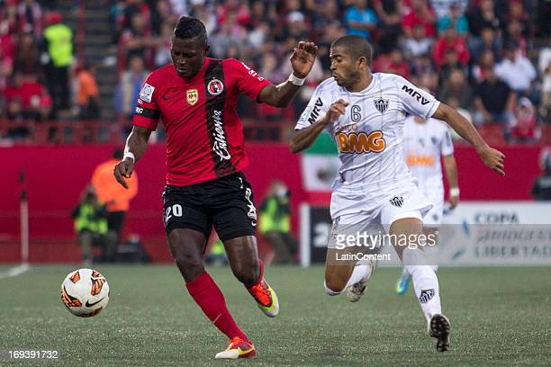 Duvier Riascos of Xolos fights for the ball with Júnior Machado of Atletico Mineiro during match between Xolos and Atletico Mineiro as part of the...