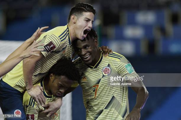 Duván Zapata of Colombia celebrates after scoring the first goal of his team with teammate Juan Cuadrado and James Rodríguez during a match between...