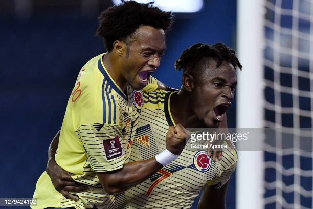 Duván Zapata of Colombia celebrates after scoring the first goal of his team with teammate Juan Cuadrado during a match between Colombia and...