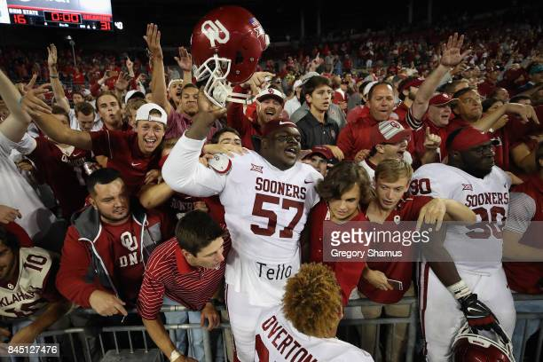 Du'Vonta Lampkin and Neville Gallimore of the Oklahoma Sooners celebrate with fans after defeating the Ohio State Buckeyes 3116 at Ohio Stadium on...