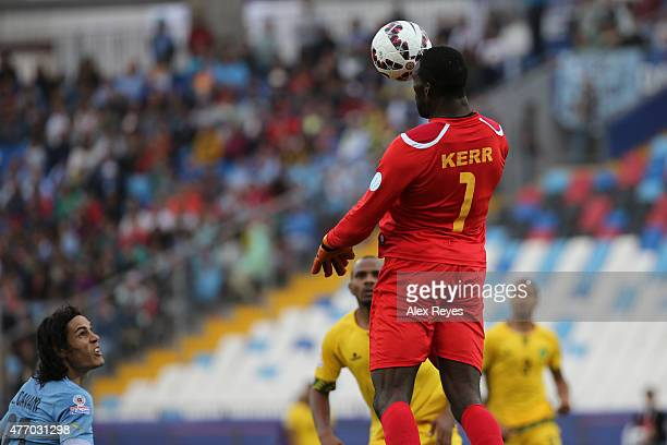 Duwayne Kerr of Jamaica jumps to head ball during the 2015 Copa America Chile Group B match between Uruguay and Jamaica at Regional Calvo y Bascuñan...