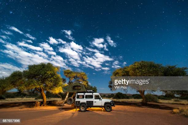 duwisib Namibia Long exposure of a Land Rover parked in the desert
