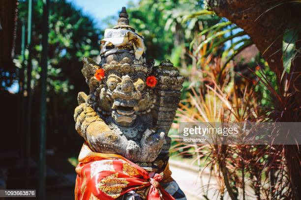 dvarapala guardian at the entrance of a temple in bali, indonesia - balinese culture stock pictures, royalty-free photos & images