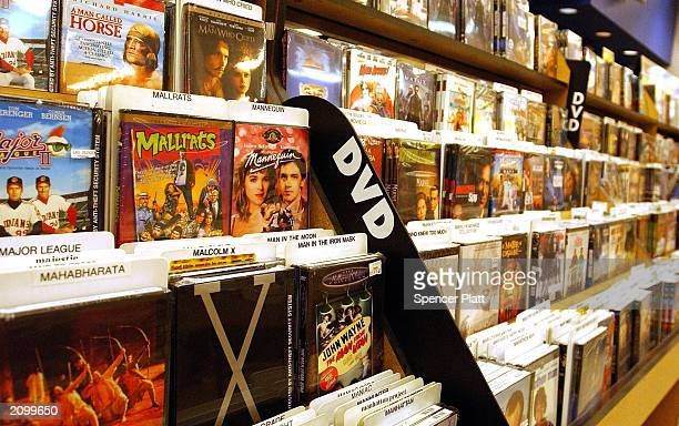 DVDs sit on a shelf June 20 2003 in New York City For the first time last week weekly rentals of DVDs surpassed VHS videos According to the trade...