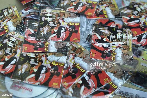 DVDs titled Hala's Birthday Party showing Uday Saddam Hussein one of the toppled leader's sons and an unidentified woman are seen on display at the...
