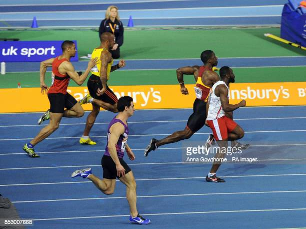 Dwain Chambers and Sean Safo Antwi in action in the Men's 60 metre semi final during day one of the British Athletics Indoor Championships at the...