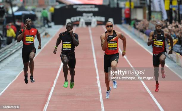 Dwain Chambers is beaten by Wallace Spearmon in the Men's 150m event during the Great CityGames on Deansgate Manchester