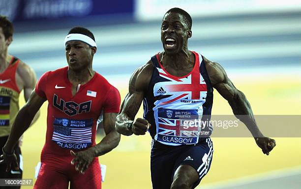 Dwain Chambers of Great Britain celebrates after winning the Mens 60 metres beating Michael Rodgers of the USA during the British Athletics...