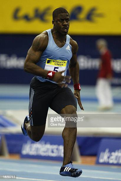 Dwain Chambers of Great Britain in action in the Mens 60 metres heats during the Norwich Union Grand Prix held on February 21 2003 at the National...