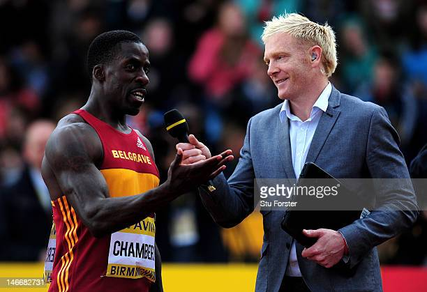 Dwain Chambers of Great Britain is interviewed by Iwan Thomas during the Men's 100 Metres Heats during day one of the Aviva 2012 UK Olympic Trials...