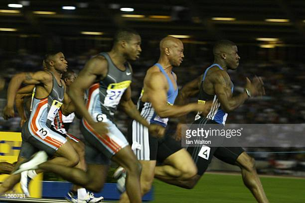 Dwain Chambers of Great Britain leads from Maurice Greene and Tim Montgomery of the USA in the 100m during the IAAF Norwich Union British Grand Prix...