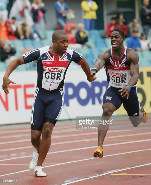 Dwain Chambers of Great Britain passes the baton to team mates Darren Campbell during the Men's 4 x 100 Metres Relay Final on day seven of the 19th...