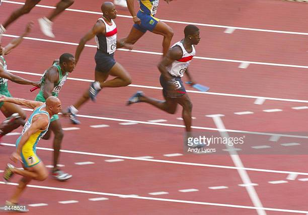Dwain Chambers of Great Britain runs the anchor on the 4 x 100m team relay heats at the 9th IAAF World Athletics Championship at the Stade de France...