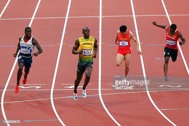 Dwain Chambers of Great Britain Usain Bolt of Jamaica and Bingtian Su of China and Antoine Adams of Saint Kitts and Nevis compete in the Men's 100m...