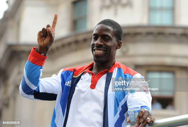 Dwain Chambers waves to the crowds as he takes part in a parade through London celebrating Britain's Olympic and Paralympic sporting heroes