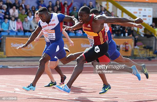 Dwain Chambers wins the Men's 100m final from Harry AkinesAryeetey during the Sainsbury's British Championships Birmingham Day Three at Birmingham...