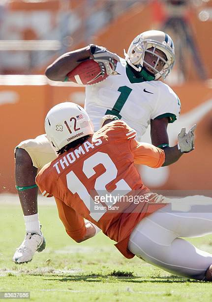 Dwain Crawford of the Baylor Bears carries the ball as he is tackled by Earl Thomas of the Texas Longhorns on November 8 2008 at Darrell K RoyalTexas...