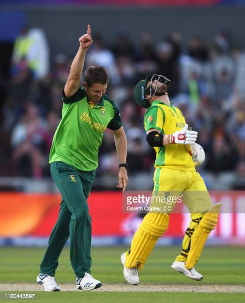 Dwaine Pretorius of South Africa celebrates after taking the wicket of David Warner of Australia during the Group Stage match of the ICC Cricket...