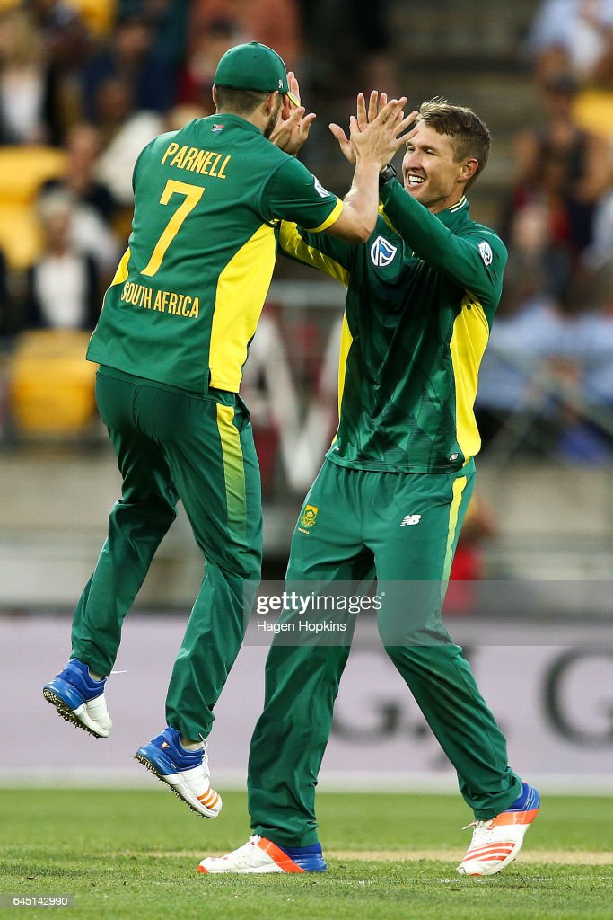 Dwaine Pretorius of South Africa celebrates with Wayne Parnell after taking the wicket of Mitchell Santner of New Zealand during game three of the One Day International series between New Zealand and South Africa at Westpac Stadium on February 25, 2017 in Wellington, New Zealand.