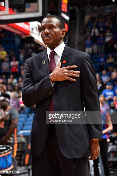 Dwane Casey of the Detroit Pistons listens to the national anthem before the game against the Orlando Magic on February 12, 2020 at Amway Center in...