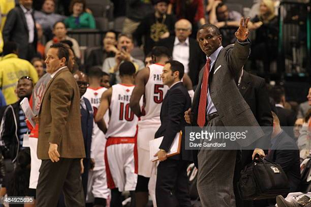 Dwane Casey of the Toronto Raptors coaches against the New York Knicks at the Air Canada Centre on April 11 2014 in Toronto Ontario Canada NOTE TO...