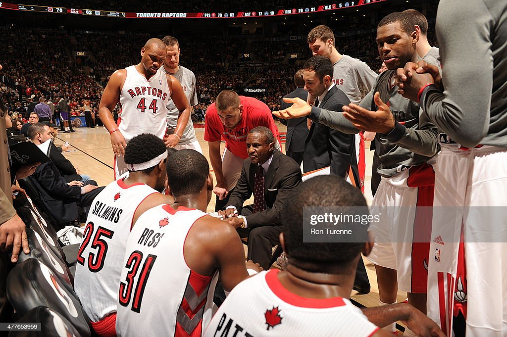 Dwane Casey of the Toronto Raptors huddles his team up during the game against the Sacramento Kings on March 7, 2014 at the Air Canada Centre in Toronto, Ontario, Canada.