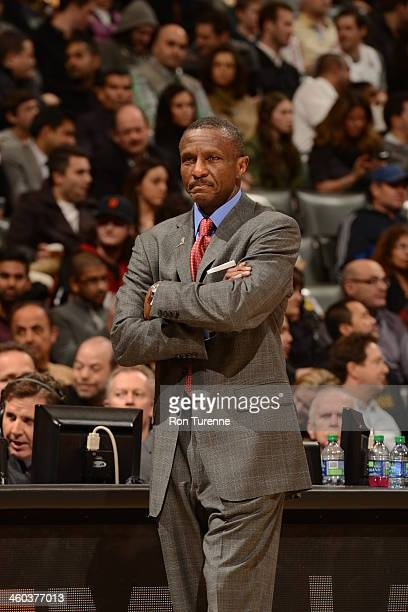 Dwane Casey of the Toronto Raptors looks on during the game against the Miami Heat on November 29 2013 at the Air Canada Centre in Toronto Ontario...