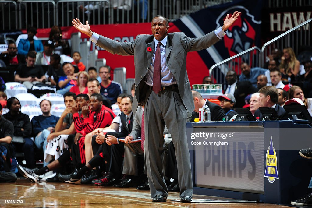 Dwane Casey of the Toronto Raptors questions a call against the Atlanta Hawks on November 1, 2013 at Philips Arena in Atlanta, Georgia.