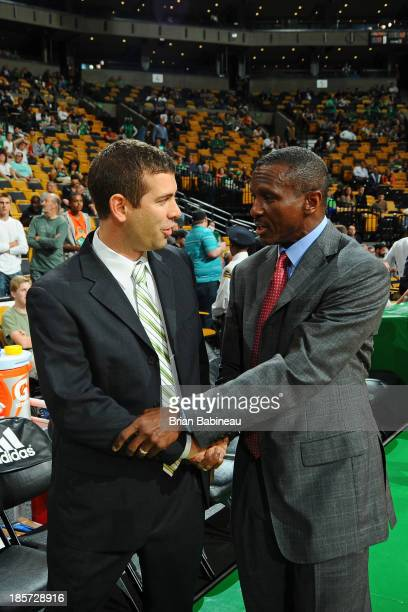 Dwane Casey of the Toronto Raptors shakes hands with Brad Stevens of the Boston Celtics coaches during the game against the Toronto Raptors on...