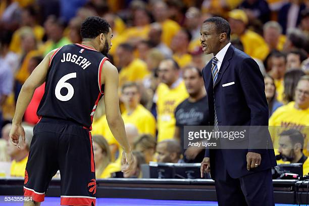Dwane Casey of the Toronto Raptors speaks to Cory Joseph in the first half against the Cleveland Cavaliers in game five of the Eastern Conference...