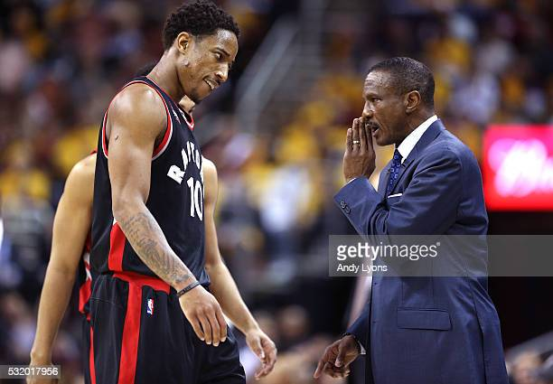 Dwane Casey of the Toronto Raptors speaks to DeMar DeRozan in the third quarter against the Cleveland Cavaliers in game one of the Eastern Conference...