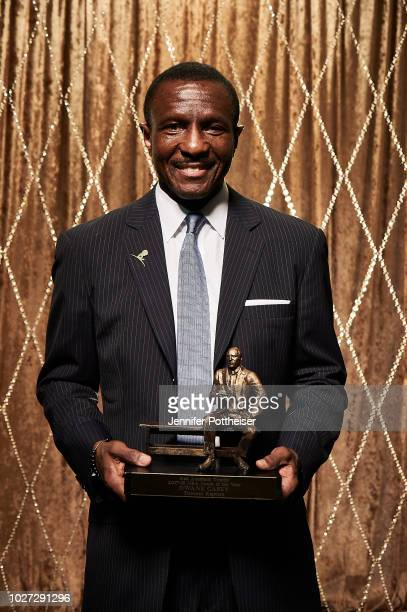 Dwane Casey poses for a portrait with the Red Auerbach Trophy after winning the NBA Coach of the Year Award during the NBA Awards Show on June 25,...
