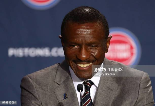 Dwane Casey poses with Tom Gores owner of the Detroit Pistons and Ed Stefanski senior adviser at Little Caesars Arena on June 20 2018 in Detroit...