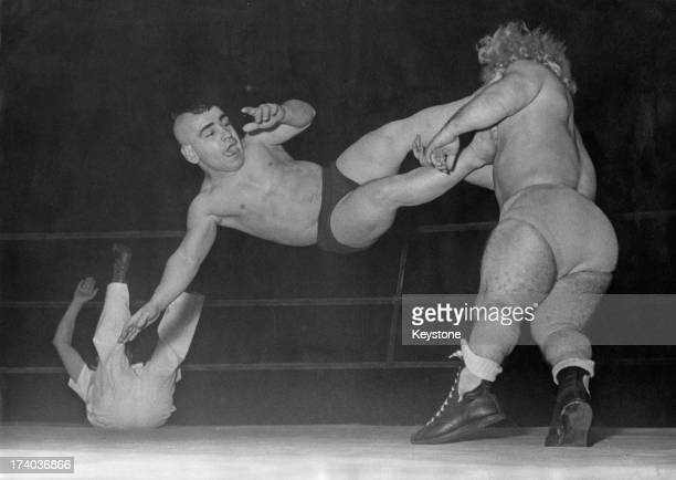A 'dwarf catching' match at the Palais des Sports in Paris France 29th January 1957 Here the referee is downed by a swipe from the wrestlers Canada's...