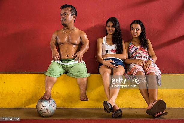 Dwarf football player watches a training session