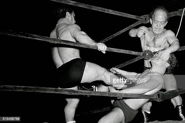 Dwarf wrestlers Sky Los Low and Major Tom Thumb apply vigorous poundings on Lilliputian adversary Lord Clayton Littlebrook in a four man match staged...